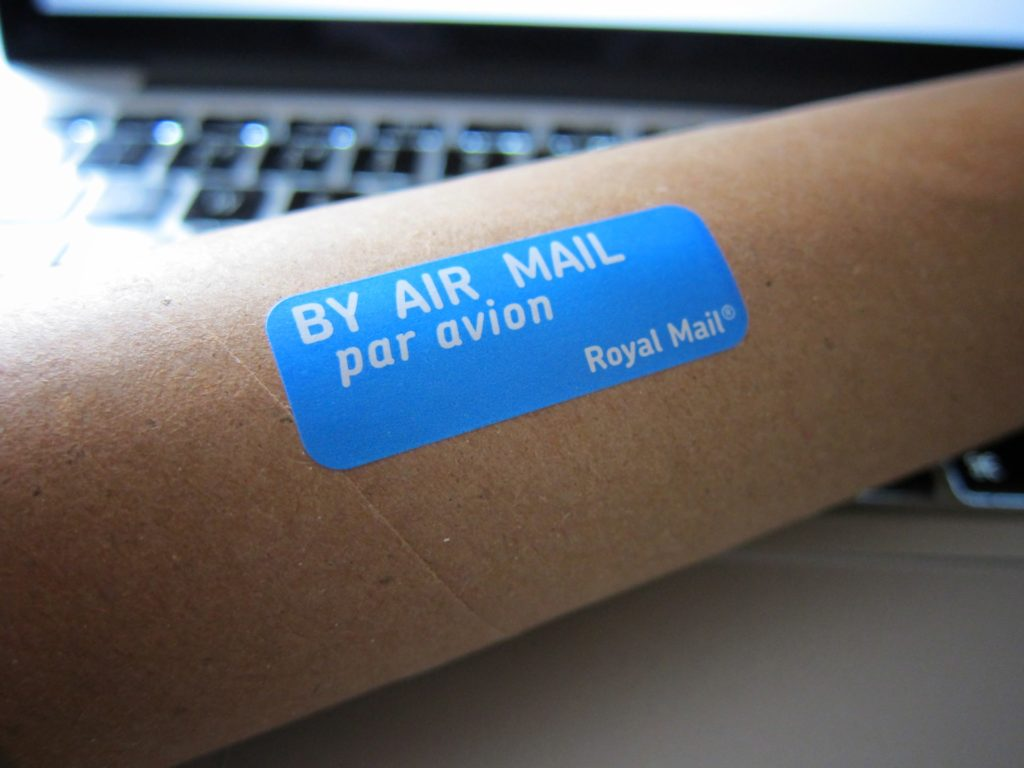 blue air mail sticker on brown surface